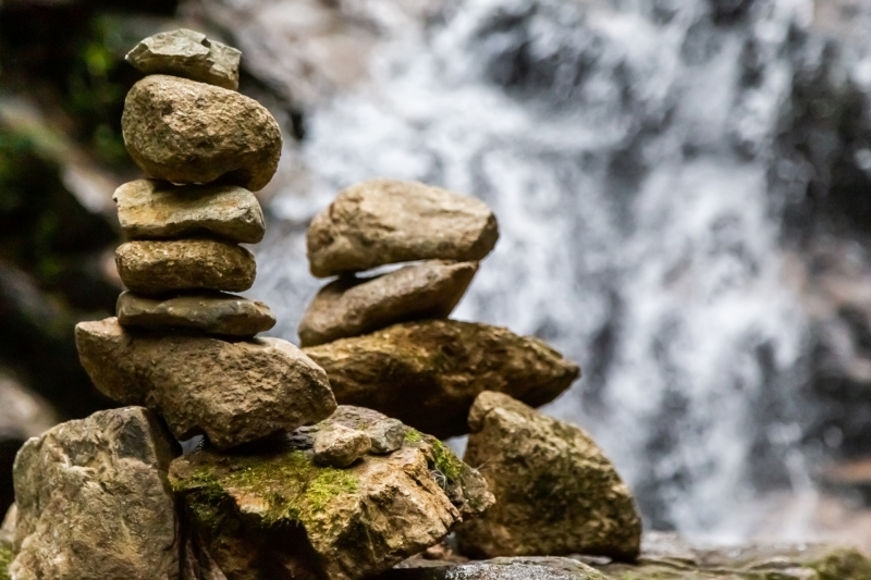 Cairns at a waterfall in Colombia.