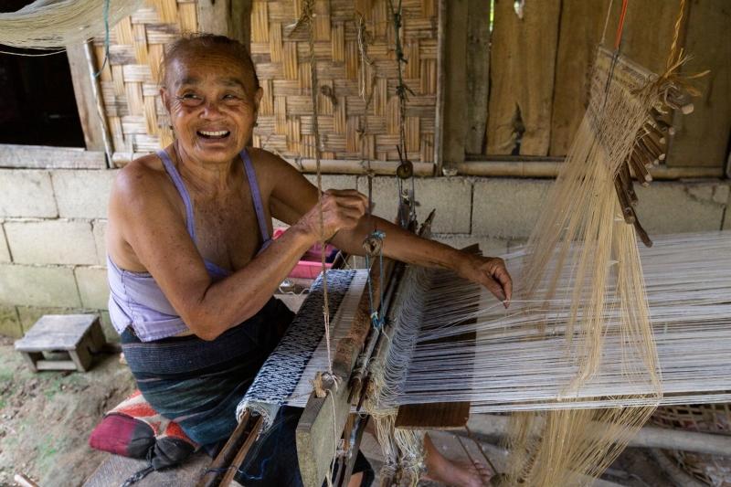 Lady Weaving Bookbags in Laos