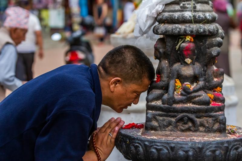 Praying at Swayambhunath Temple