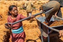 Nepalese Girl Helping Shovel