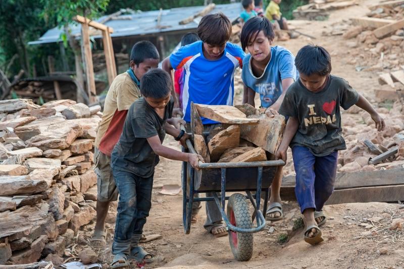 Village Kids Helping Carry Bricks