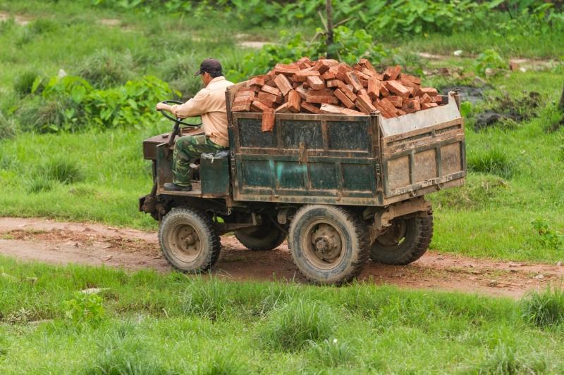 Man Driving a Truck of Bricks