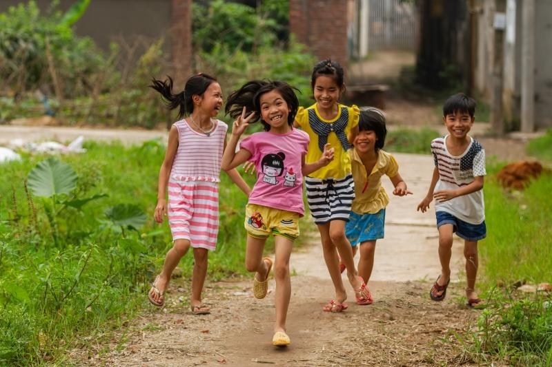 Children Smiling and Running