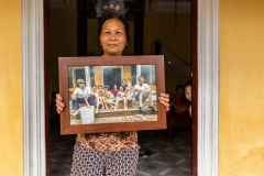 Woman Holding Family Photo
