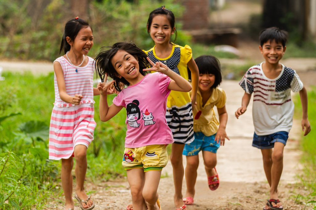 Children running and playing outside