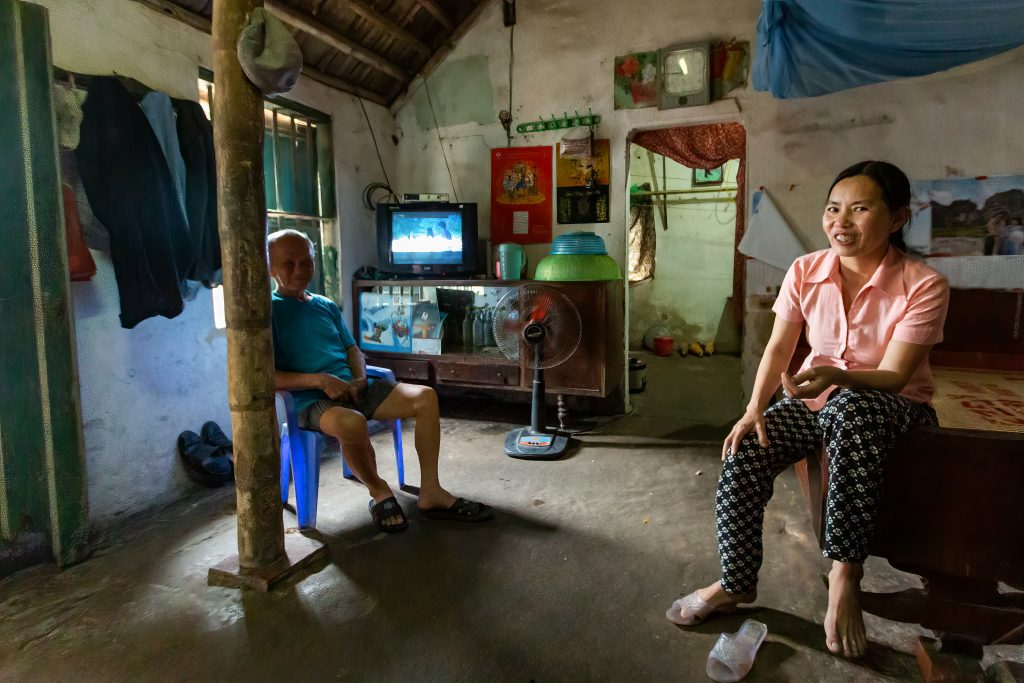 Vietnamese father and daughter at home