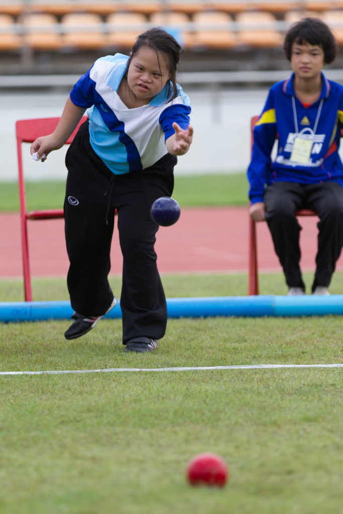 girl lawn bowling at the special olympics