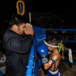 child fighter praying with coach