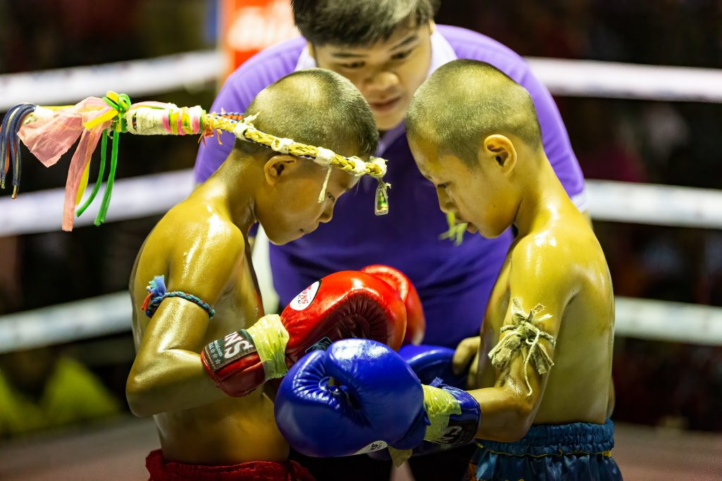 Children praying before a muay thai kickboxing match.