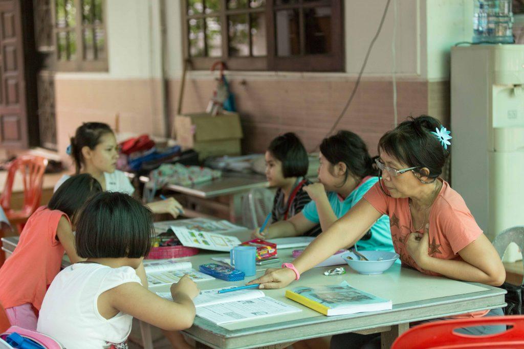 Woman teaching children
