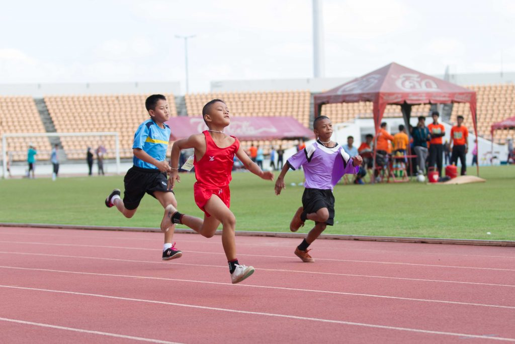 children running track at the Thailand Special Olympics