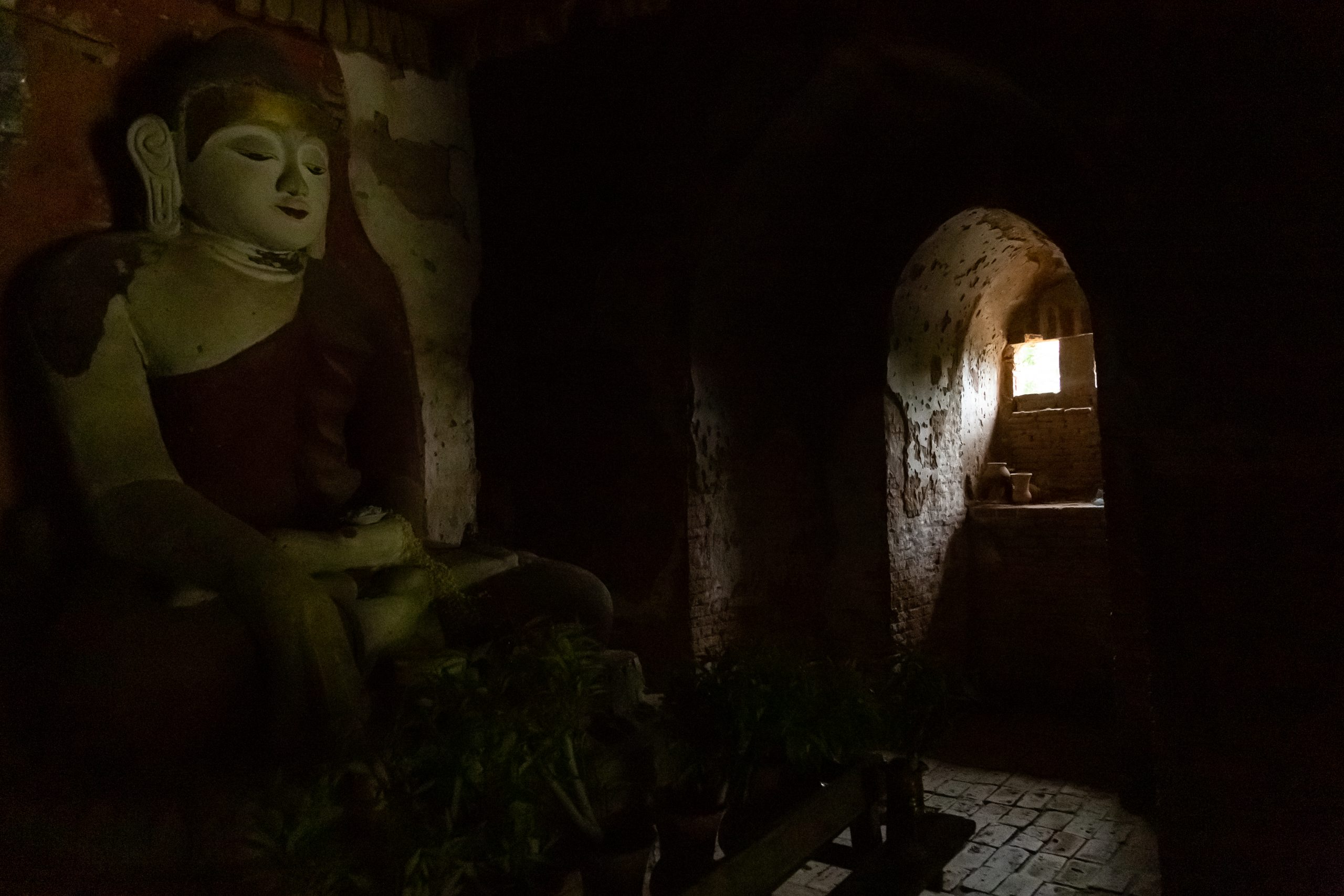 light shining on Buddha in temple