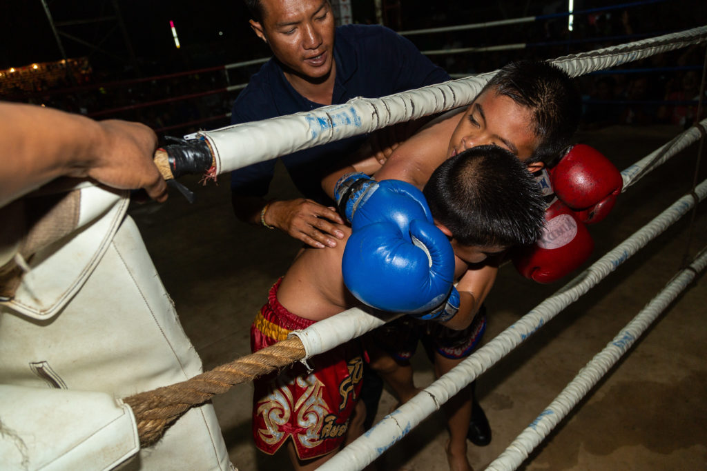muay thai fighters falling out of the ring